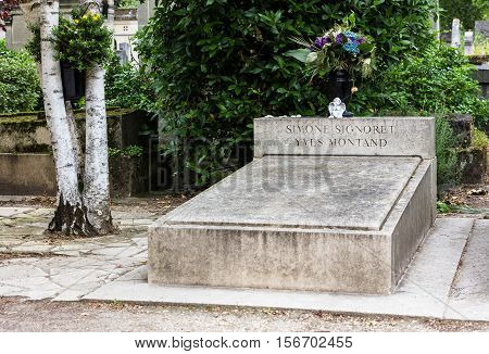 Paris France - Jule 11 2016: Simone Signoret's and Yves Montand's grave at Pere Lachaise cemetery.World's most visited cemetery attracting thousands of visitors to graves of those who have enhanced French life over past 200 years.