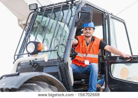 Manual Worker on Skid Steer Loader, toned image,