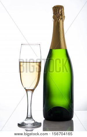 Champagne bottle and  cup on white  background