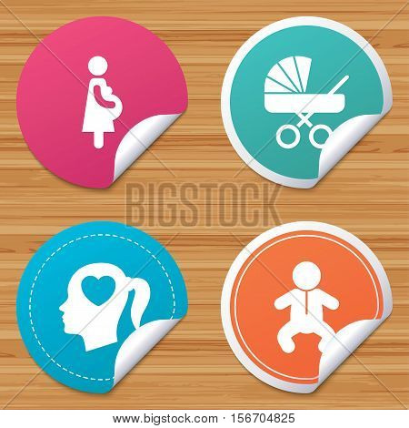 Round stickers or website banners. Maternity icons. Baby infant, pregnancy and buggy signs. Baby carriage pram stroller symbols. Head with heart. Circle badges with bended corner. Vector