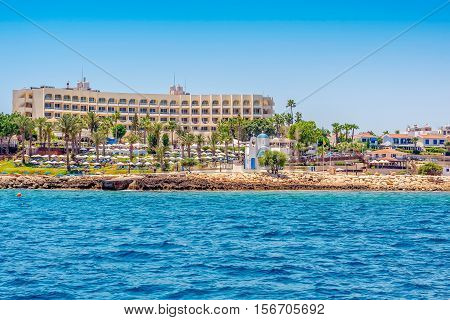 Coastal line of fig tree bay Agios Nikolaos Church and Hotels. Famagusta District Cyprus.