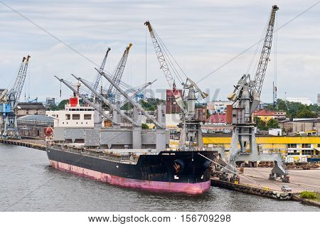 Commercial Cargo ship docked in port - Freight transportation
