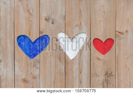 french flag colors carved into wooden love hearts