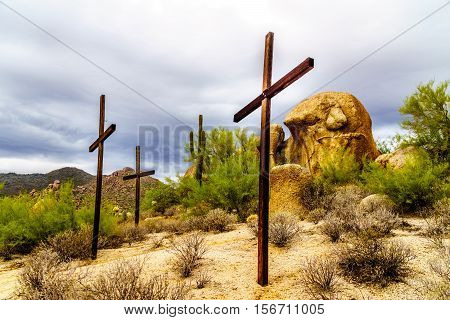 Three Crosses on a Hillside and near Boulders in the desert near Carefree, Arizona, USA