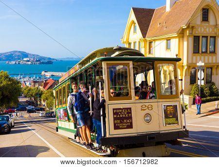 Closeup Passengers Riding Sf Cable Car Alcatraz