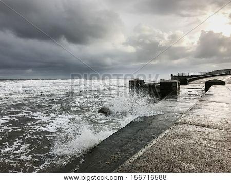 SCARBOROUGH ENGLAND - NOVEMBER 6: Rough sea crashing at Scarborough South Bay. In Scarborough England. On 6th November 2016.