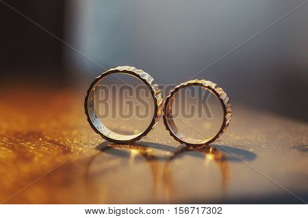 Wedding Rings Solo On The Woden Table
