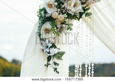 Wedding Altar Decorated With White Flowers And Crystals
