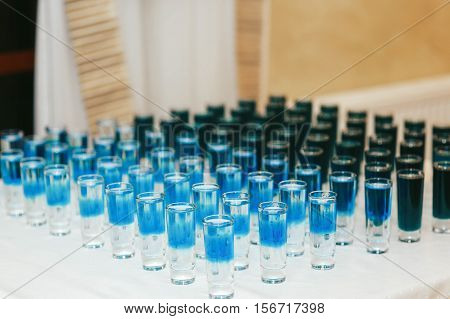 Blue Shots Served In Ranges On The Table