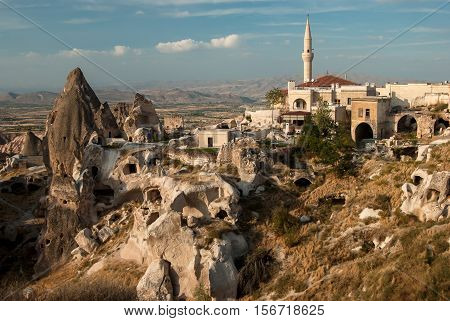 Minaret in Uchisar cave and the ruins of the settlements. Cappadocia Turkey.