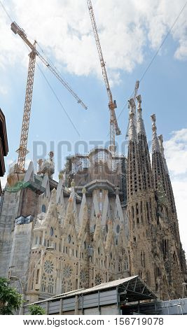BARCELONA, CATALONIA, SPAIN - JUNE 16: The cranes are towering over the construction site of Sagrada Familia temple on June 16, 2014 in Barcelona, Catalonia, Spain.