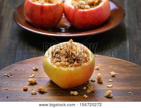 Homemade baked apples stuffed with nut and honey close up view