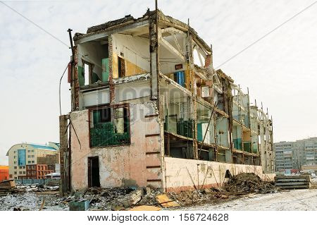 Tyumen, Russia - February 16, 2008: Demolition of machine-tool factory. Shell of partially demolished building