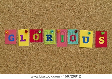 Glorious word written on colorful sticky notes pinned on cork board.