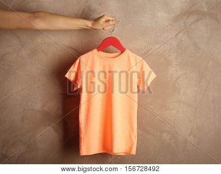 Blank orange t-shirt on grunge background