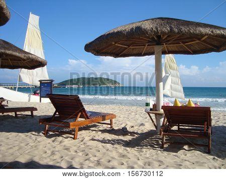 Sunbeds on Beach with white sand on island