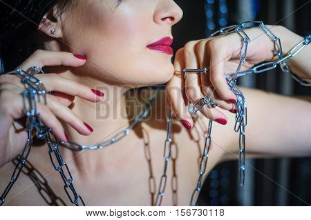 beautiful model in the artistic image of the captive in the Studio.