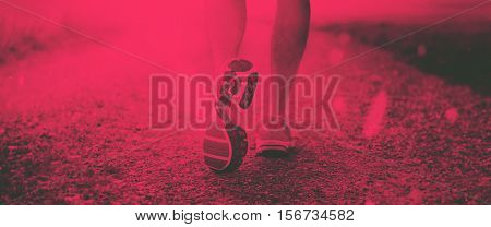 Closeup of runner with running shoes. Duotone Effect.