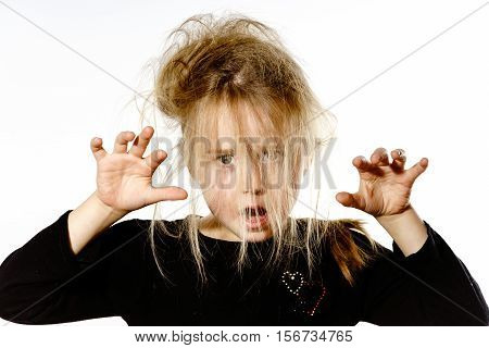Disheveled Preschooler Girl With Long Hair Posing