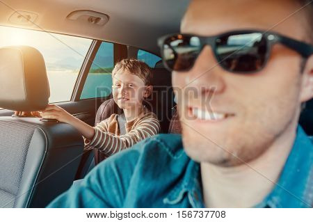 I like to travel with my dear father