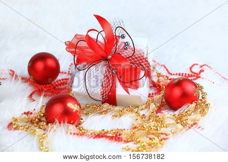 Christmas gift in a beautiful package and Christmas decoration on white background. is there a photo blank for your text