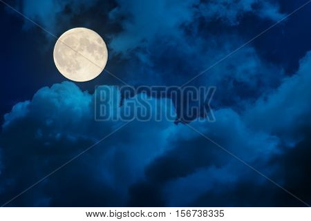 supermoon in dramatic clouds
