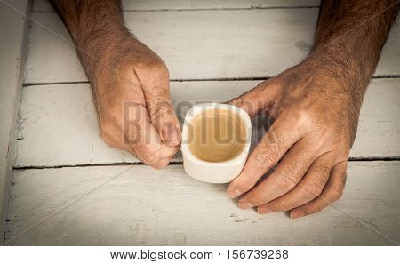 man holding a cup of coffe with vintage process