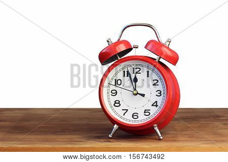 Red retro alarm clock at twelve o'clock on white background isolate. Midnight midday. Minutes about New year.