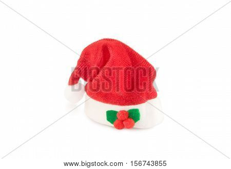 Red holiday Santa hat isolated over white. Christmas and New Year theme.