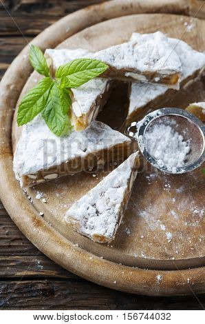 Traditional italian dessert panforte with nut selective focus