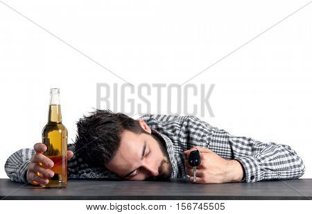 Young drunk man with car key and bottle of beer on grey background