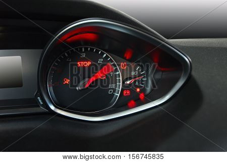 Tachometer reaching the red zone, sports car inside