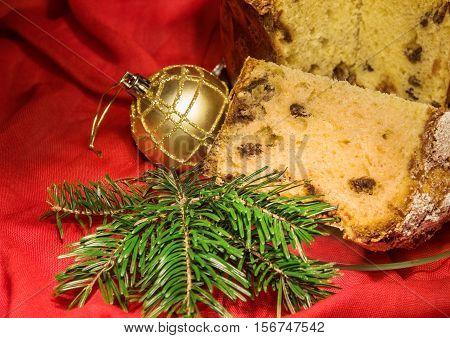 Cut Panettone, Branch Of Fir Tree, Golden Bauble. Christmas Theme.