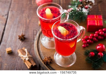 Christmas card. hot spicy Christmas drink of cranberry and spice and Christmas decorations.