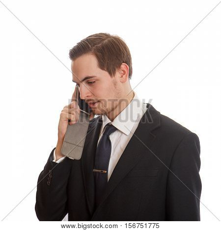 Young businessman in a suit talking on his phone