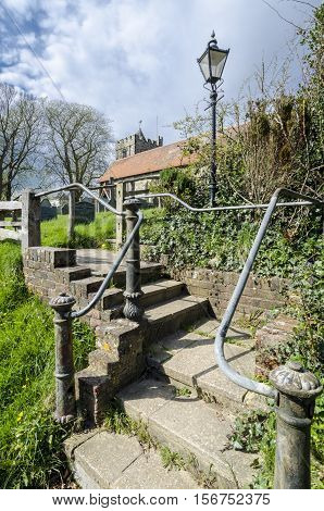 Steps leading to Brede village churchyard Kent UK