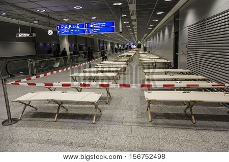 Empty Camp Beds Are Standing Row By Row In The Airport Terminal