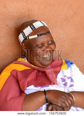 LESEDI CULTURAL CENTER, SOUTH AFRICA-NOVEMBER 5, 2016: Unidentified Ndebele tribe woman wearing her traditional tribal clothing.