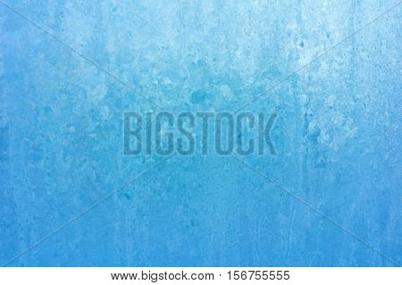 Abstract Blue Frozen Background of Ice Frosty Patterns on Winter Window