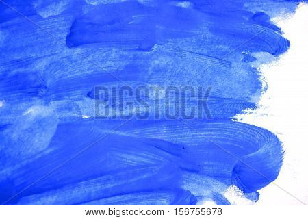 uncertain chaotic backdrop. strokes of blue paint made by a finger. blue finger smears on a white background isolated. abstract background space for text base