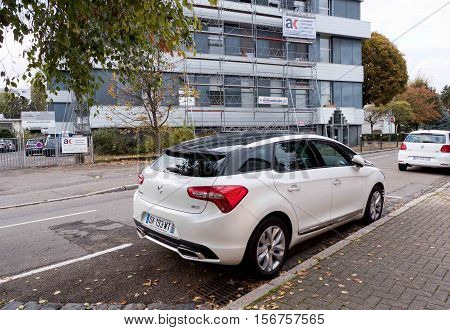 STRASBOURG FRANCE - NOV 6 2016: Rear view of white Luxury DS 5 family van parked on French city street.The DS 5 is a upmarket large family car designed and developed by the French automaker Citroen that was launched for the European market in November 201