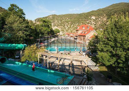 Glenwood Springs, USA - September 7, 2015: People bathe at public hot springs pool with water slide