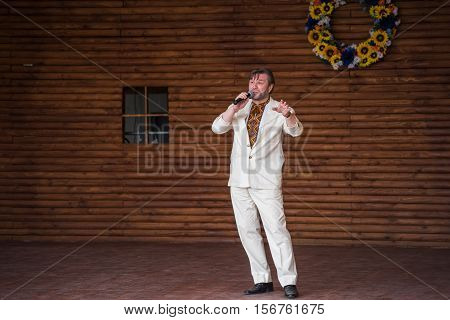 Silver Spring, USA - September 17, 2016: Ukrainian opera singer Oleh Chmyr on stage in traditional costume
