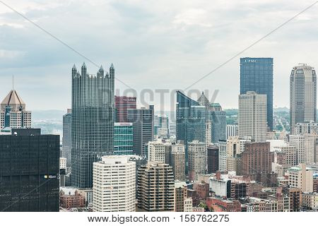 Pittsburgh, USA - June 3, 2016: Cityscape or skyline with bank skyscrapers such as UPMC on overcast day