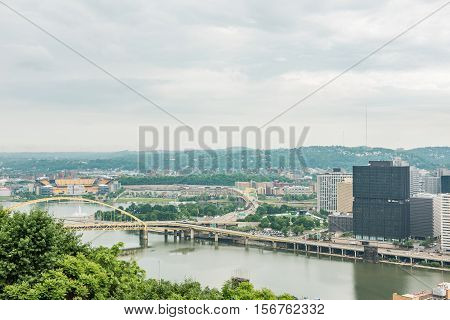 Pittsburgh, USA - June 3, 2016: Cityscape or skyline view of Allegheny and Ohio rivers and Heinz field with bridge