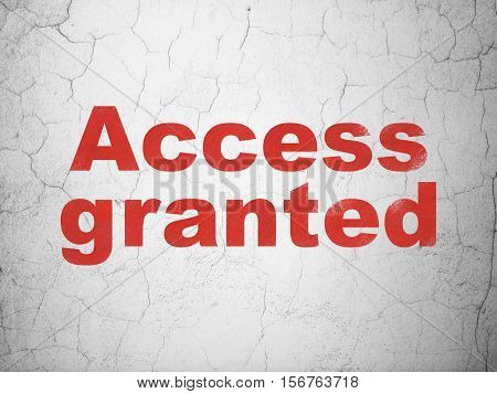 Protection concept: Red Access Granted on textured concrete wall background