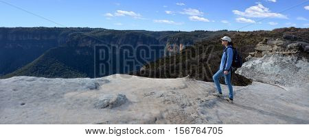 Woman Looks At The Landscape From Lincoln Rock Lookout At Sunset Of The Grose Valley Located Within