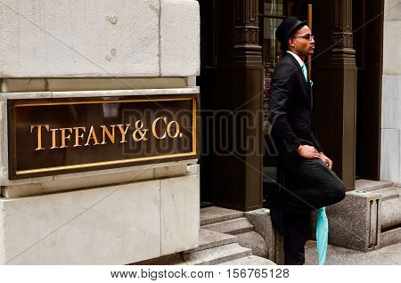 New York City, USA - May 11, 2015: Tiffany & Co. Building on Wall Street in the Financial District with doorman employee in color coordinated suit