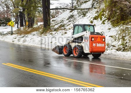 Charlottesville, USA - March 6, 2013: Bobcat snow removal truck on road in winter