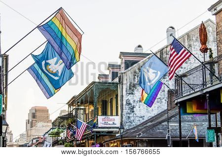 New Orleans, USA - July 8, 2015: Famous Bourbon Street with LGBT flags and stores